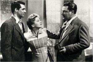 Joan Fontaine ( au centre )  entre  Gary Grant  ( à gauche )  et Nigel Bruce  (  à droite )  dans  Soupçons  d'Alfred  Hitchcok