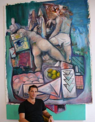 Julien Grenier devant une de ses toiles (photo JB)