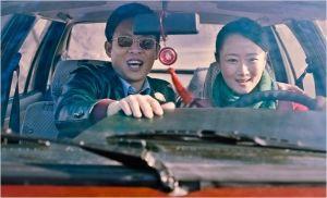 Le jeu de pouvoir et de séduction en marche : Zhang ( Zhang Yi ) et Toa ( Zhao Tao )